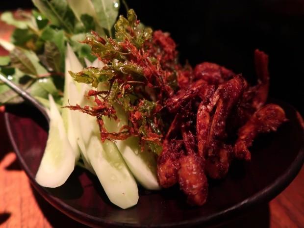 Side dish of crispy prawns and cucumber