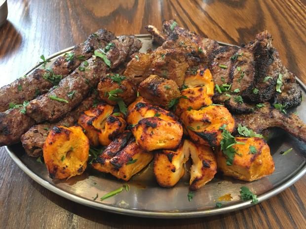 Mixed Grill - Seek Kebab [£______ x2], Lamb Tikka [£ ], Chicken Tikka [£], and Lamb Chops [£]